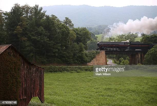 The recently restored former Norfolk and Western Railway J class steam locomotive 611 passes by during an excursion July 3 2015 in Roanoke Virginia...