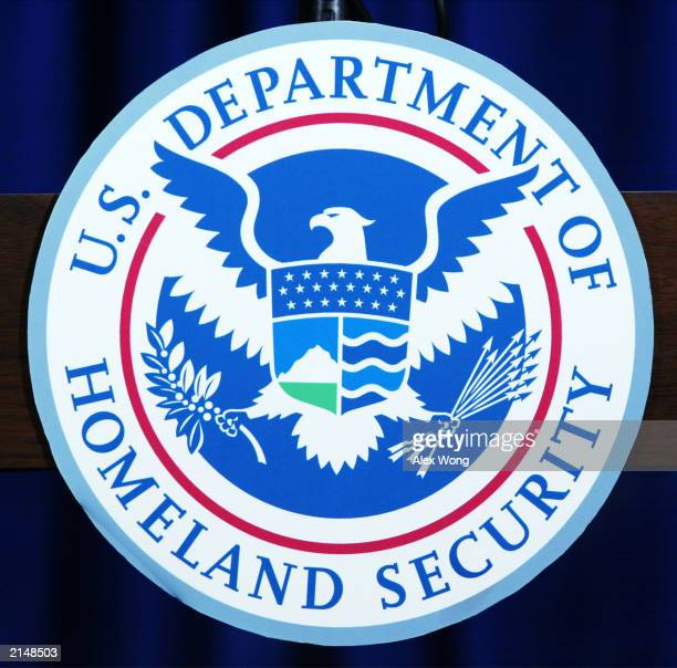 The recently unveiled seal of the US Department of Homeland Security is shown displayed on a podium at a media conference announcing Operation...