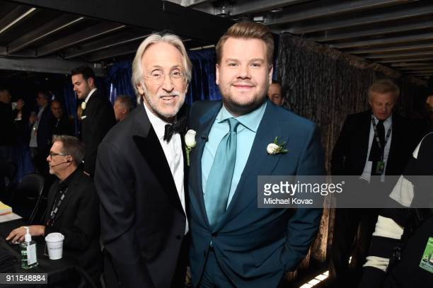 The Recording Academy and MusiCares President/CEO Neil Portnow and host James Corden pose backstage at the 60th Annual GRAMMY Awards at Madison...