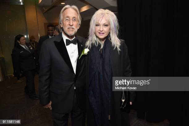 The recording academy and MusiCares president/CEO Neil Portnow and recording artist Cyndi Lauper appears backstage during the 60th Annual GRAMMY...
