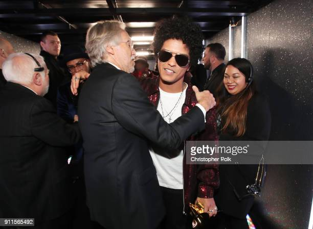 The Recording Academy and MusiCares President/CEO Neil Portnow greets recording artist Bruno Mars winner of Album of the Year for '24K Magic'...