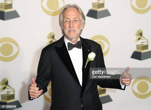 The Recording Academy and MusiCares President/CEO Neil Portnow poses in the press room at the 60th Annual GRAMMY Awards at Madison Square Garden on...