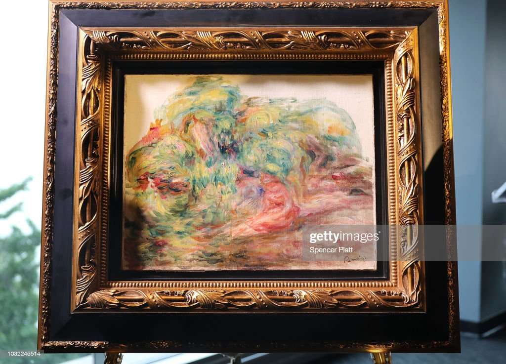 The recovered Impressionist painting 'Two Women in a Garden,' painted in 1919 by Pierre-Auguste Renoir is displayed at a news conference on September 12, 2018 in New York City. The work of art originally belonged to Sylvie Sulitzer's grandfather Alfred Weinberger and was stolen by the Nazis in Paris during the World War II. The only living heir, Sylvie Sulitzer became aware of the work in 2013, when the painting had been listed for sale at Christie's in New York. With the Help of the FBI and the United States attorney's office in Manhattan the painting was finally returned to her at a ceremony at the Museum of Jewish Heritage in Lower Manhattan.