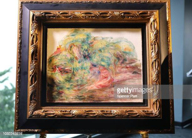 The recovered Impressionist painting Two Women in a Garden painted in 1919 by PierreAuguste Renoir is displayed at a news conference on September 12...