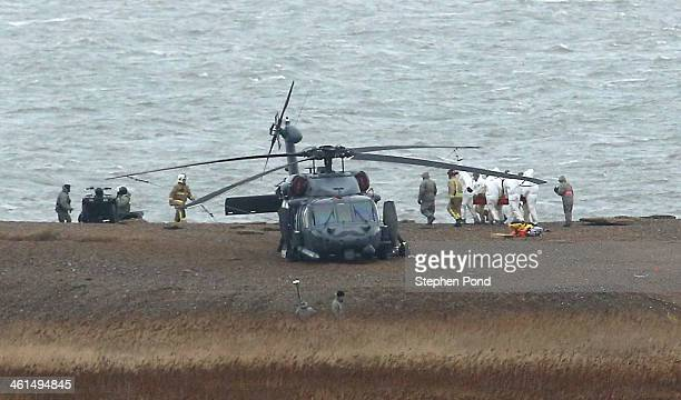 The recovery effort continues as military personnel and emergency services attend the scene on the coast after a US Air Force helicopter crashed on...