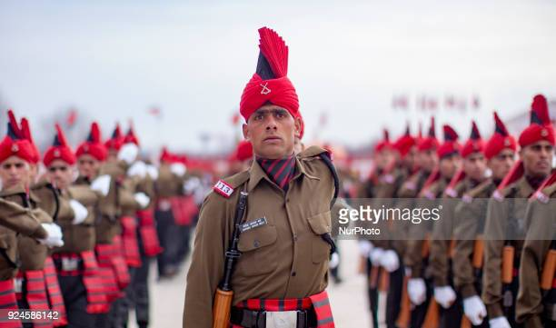 The recruits of Indian army from Kashmir stand in formation during their passing out parade at a garrison in Rangreth on February 26 2018 in the...