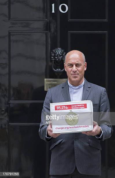 The Rector of Woolwich Reverend Jesse van der Falk poses for photographers as he arrives to present a petition bearing over 85000 signatures calling...