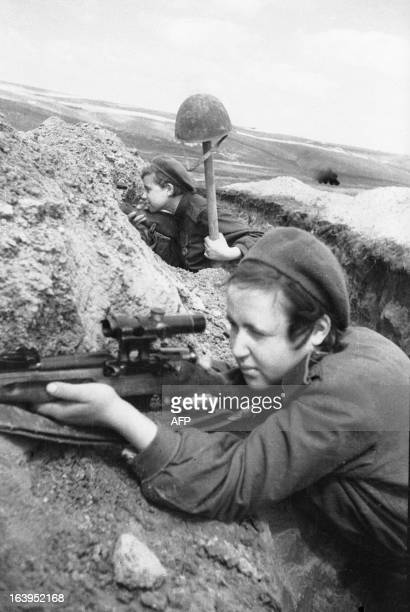 The Red Army Soviet snipers shooting from a trench in 1943 AFP PHOTO/Ozersky/RIA Novosti
