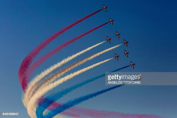 The 'Red Arrows' aerobatic team from Britain performs during Athens Flying Week at Tanagra air base north of Athens on September 17 2017 The...