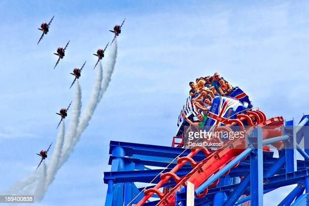 "The ""Red Arrows"" air display team fly over the ""Big One"" Amusement Park roller coaster."