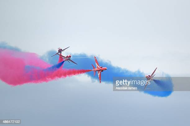 The Red Arrows at Rhyl Airshow breaking formation