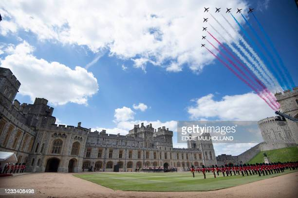 The Red Arrows conduct a flypast as Britain's Queen Elizabeth II watches a military ceremony to mark her official birthday at Windsor Castle on June...