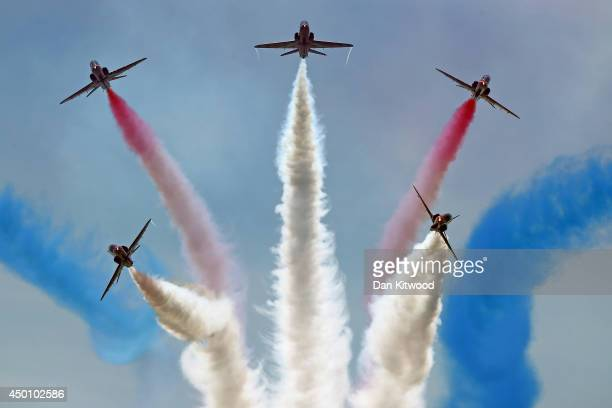 The Red Arrows display team perform over Southsea Common at the end of a commemoration service of the DDay landings on June 5 2014 in Portsmouth...