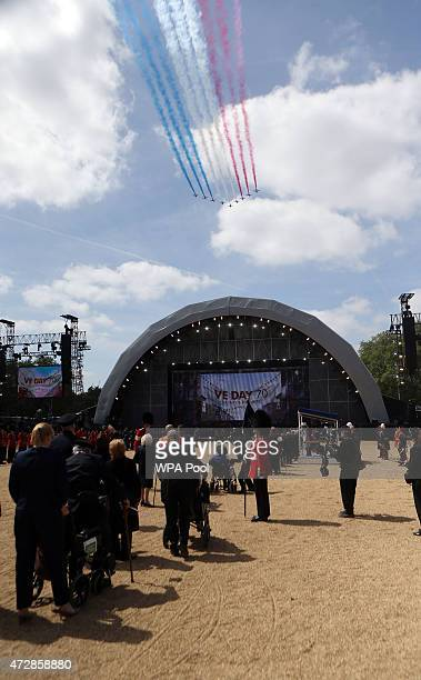 The Red Arrows fly above Horse Guards Parade during the VE Day Parade to mark the 70th anniversary of VE Day at Horse Guards Parade on May 10 2015 in...