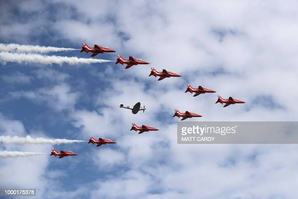 The Red Arrows fly in formation during the Farnborough Airshow south west of London on July 16 2018 Britain sought to project an image of aerospace...