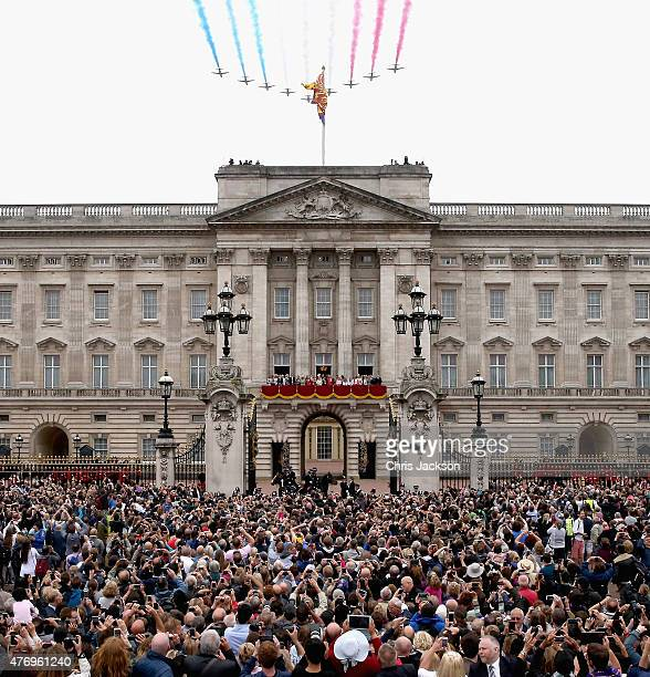 The Red Arrows fly over Buckingham Palace as the Royal Family look out from the balcony of Buckingham Palace during the Trooping the Colour on June...