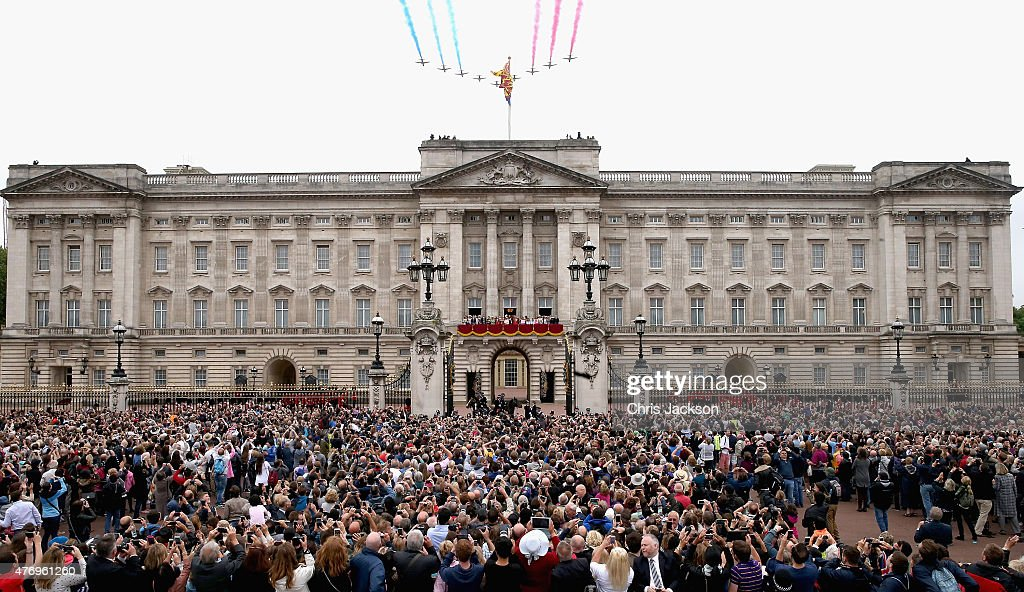 The Red Arrows fly over Buckingham Palace as the Royal Family look out from the balcony of Buckingham Palace during the Trooping the Colour on June 13, 2015 in London, England. The ceremony is Queen Elizabeth II's annual birthday parade and dates back to the time of Charles II in the 17th Century when the Colours of a regiment were used as a rallying point in battle.