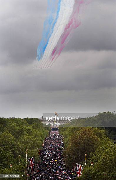 The Red Arrows fly over Buckingham Palace during the Diamond Jubilee celebrations on June 5 2012 in London England For only the second time in its...
