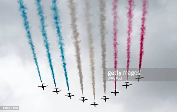 The Red Arrows fly over Buckingham Palace during Trooping the Colour Queen Elizabeth II's Birthday Parade at The Royal Horseguards on June 14 2014 in...