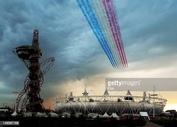The Red Arrows fly over Olympic Stadium during the Opening Ceremony for the 2012 Summer Olympic Games on July 27, 2012 at Olympic Park in London,...