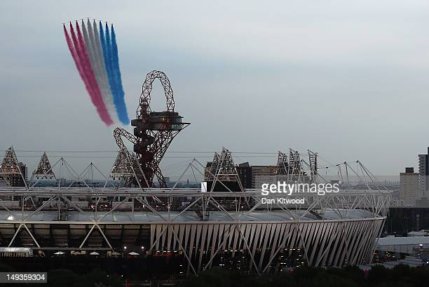 The Red Arrows fly over the Olympic Stadium and the ArcelorMittal Orbit Tower ahead of the opening ceremony of the 2012 London Olympic Games on July...