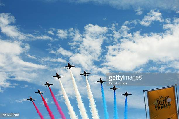 The Red Arrows fly past Harewwood House at the start of the first stage of the 2014 Tour de France a 190km stage between Leeds and Harrogate on July...