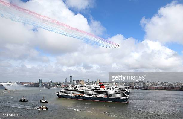 The Red Arrows perform a fly past as the three Cunard Queens Queen Mary 2 Queen Elizabeth and Queen Victoria meet on the River Mersey for the first...