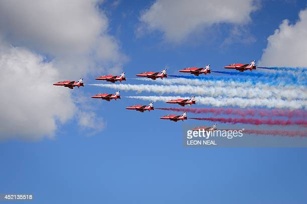 The Red Arrows perform a flypast to formally open the Farnborough air show in Hampshire England on July 14 2014 The biennial event sees leading...