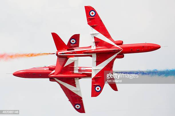 The Red Arrows perform as part of the celebrations for the their 50th display season during the Royal International Air Tattoo at RAF Fairford on...