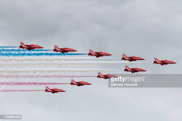 The Red Arrows perform during the International Air Tattoo at RAF Fairford on July 21, 2019 in Fairford, England. The Royal International Air Tattoo...