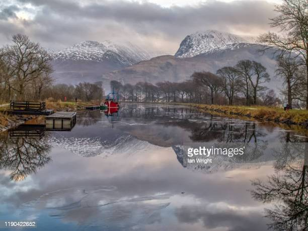 the red boat, caledonian canal, corpach - moment of silence stock pictures, royalty-free photos & images