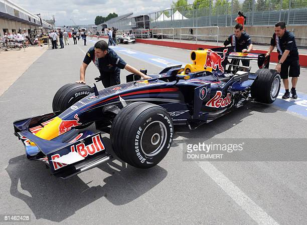The Red Bull pitt crew rolls United Kingdom driver David Coulthard's car in the pitts at the Canadian Formula One June 5 2008 in Montreal The...