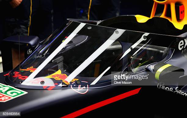 The Red Bull Racing Red BullTAG Heuer RB12 TAG Heuer fitted with the aeroscreen in the garage during previews ahead of the Formula One Grand Prix of...