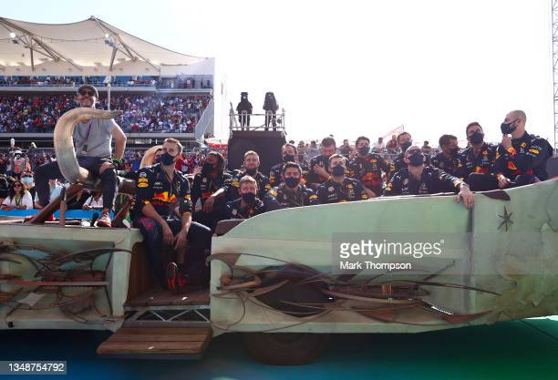 The Red Bull Racing team enjoy the podium celebrations during the F1 Grand Prix of USA at Circuit of The Americas on October 24, 2021 in Austin,...