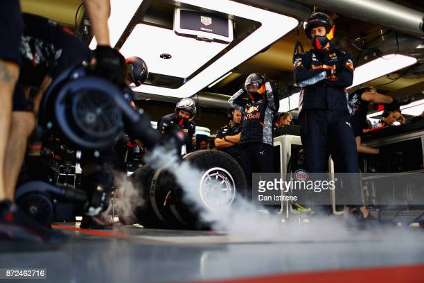 The Red Bull Racing team looks on in the garage during practice for the Formula One Grand Prix of Brazil at Autodromo Jose Carlos Pace on November 10...