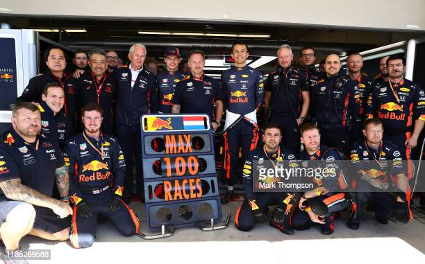 The Red Bull Racing team pose for a photo to commemorate the 100th Formula One race of Max Verstappen of Netherlands and Red Bull Racing before the...