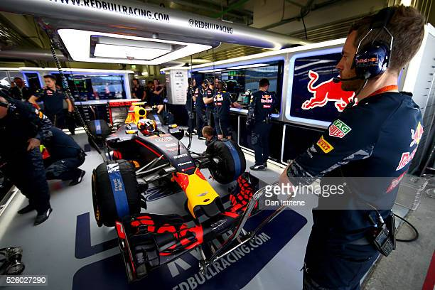 The Red Bull Racing team prepare to release Daniil Kvyat of Russia and Red Bull Racing for a run during practice for the Formula One Grand Prix of...