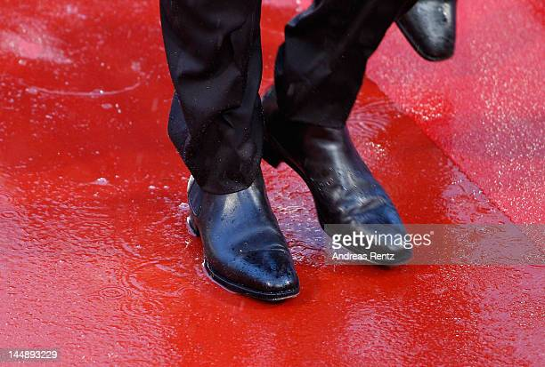 """The red carpet is soaked through with rain as guests attend the """"Amour"""" Premiere during the 65th Annual Cannes Film Festival at Palais des Festivals..."""