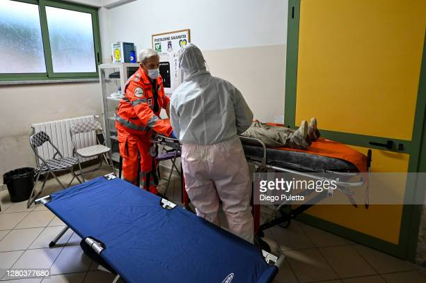 The Red Cross personnel in protective suits simulate an emergency transmission of a patient COVID19 on October 15 2020 in Turin Italy The Emergency...