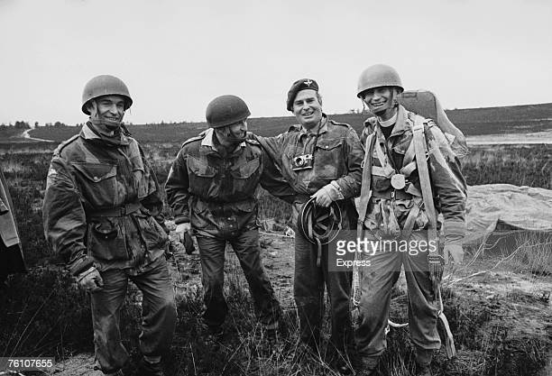 The Red Devils display team of the 16th Parachute Regiment land in a muddy puddle 24th January 1967 From left to right Padre John McNaughton Padre...