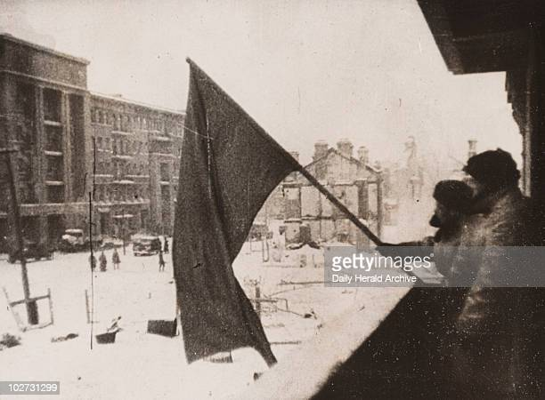 The red flag is hoisted over a recaptured part of Stalingrad, 1943. Gelatin silver print. A photograph taken during the siege of Stalingrad, Russia,...