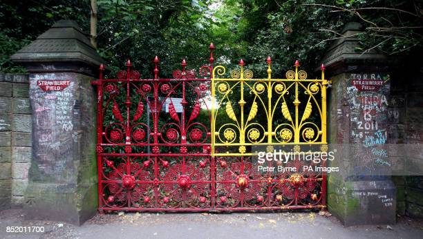 The red gate at Strawberry Fields in Liverpool made famous by The Beatles which has been painted yellow by vandals