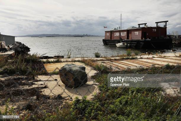 The Red Hook neighborhood in Brooklyn ends at New York Harbor on October 23 2017 in New York City Red Hook like many coastal neighborhoods in New...