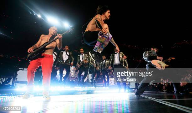 The Red Hot Chili Peppers and Bruno Mars perform during the Pepsi Super Bowl XLVIII Halftime Show at MetLife Stadium on February 2 2014 in East...
