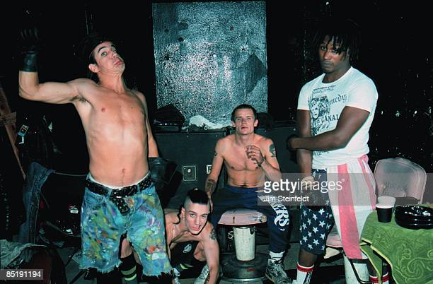 The Red Hot Chili Peppers Anthony Kiedis John Fruscianete Michael 'Flea' Balzary and DH Peligro pose for a photo backstage at First Avenue Nightclub...