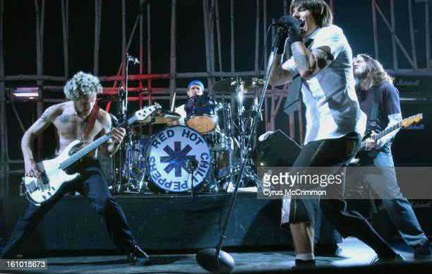 The Red Hot Chili Peppers brought their North American tour to Fiddler's Green where they played after Snoop Dogg. Left to right: Flea <cq> on bass,...