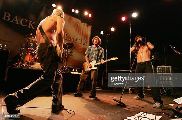 The Red Hot Chili Peppers on stage with Flea John Frusciante on Guitar and Anthony Kiedis lead vocalist