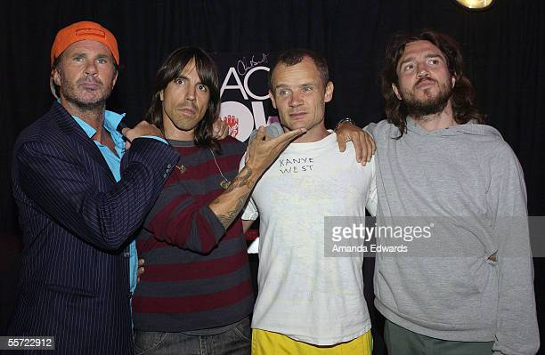 The Red Hot Chili Peppers pose backstage at the ReAct Now Music Relief benefit concert at Paramount Studios on September 10 2005 in Hollywood...