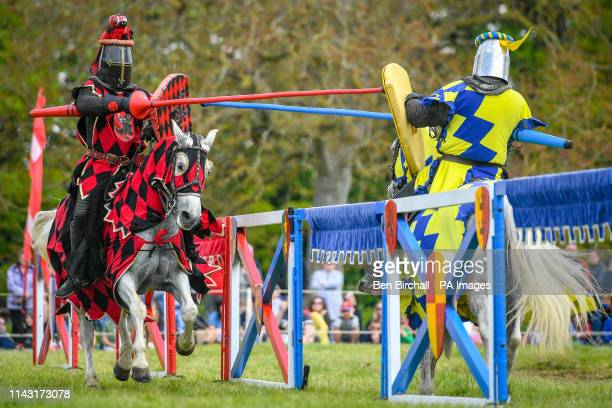 The red knight and blue knight face off as they gallop along the tilt during a jousting performance at Sudeley Castle annual jousting event in...