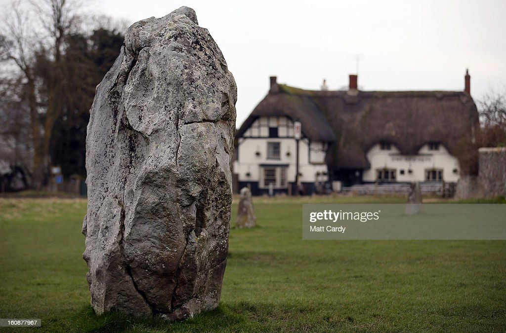 The Red Lion public house is seen beyond the Neolithic stones at Avebury on February 7, 2013 in Wiltshire, England. A leading travel magazine has recently named the collection of stones - thought to have been constructed around 2600BC and the largest stone circle in Europe, as the second best heritage site in the world. The Wiltshire world heritage site has been placed ahead of much more recognisable sites including the Valley of the Kings in Egypt, Taj Mahal in India and the Forbidden City in China.